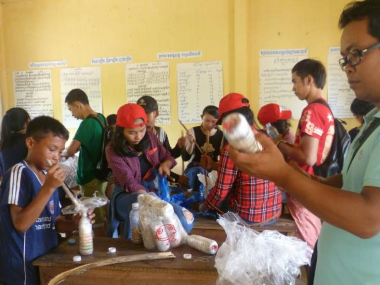 State school students help stuffing the bottles